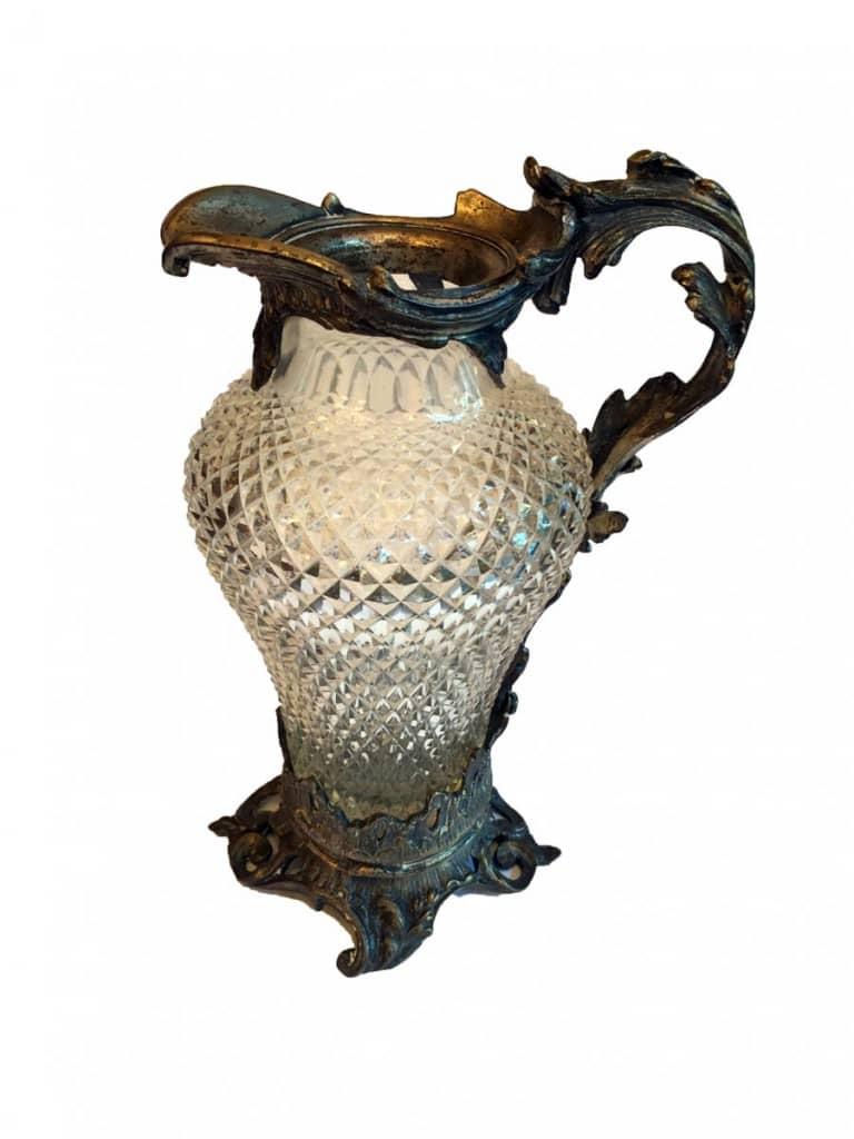 Brocca in cristallo e bronzo argentato.