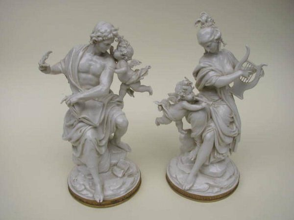 A pair of white porcelain figures signed by Giuseppe Capp 1961