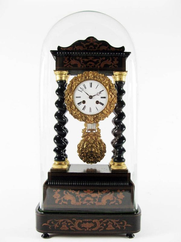 A Napoleon III French Table Clock with twist columns