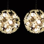 A pair of 1970s Italian Chrome and Murano Glass Chandeliers