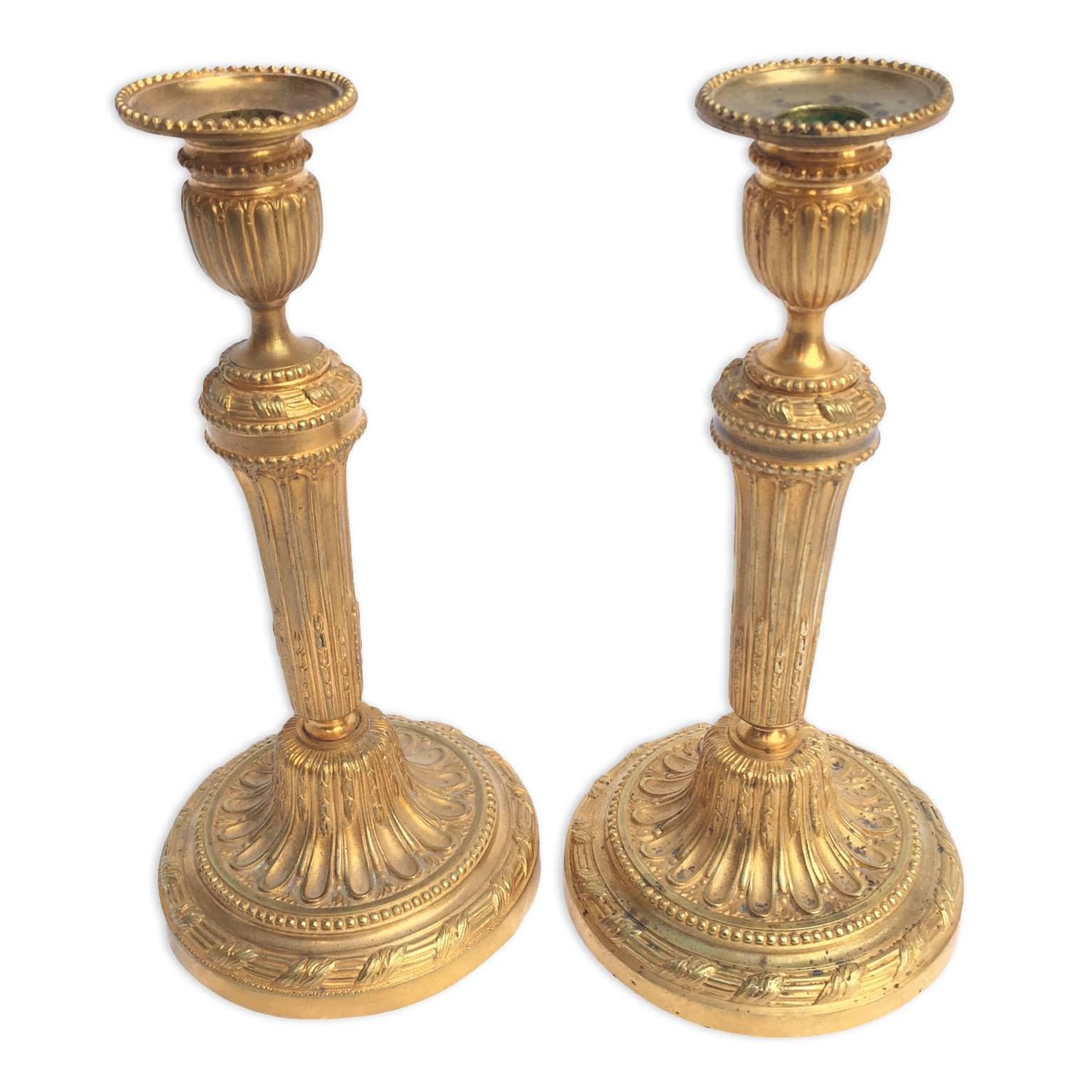 Coppia di candelieri antichi in bronzo dorato belle for Oggetti antichi in regalo