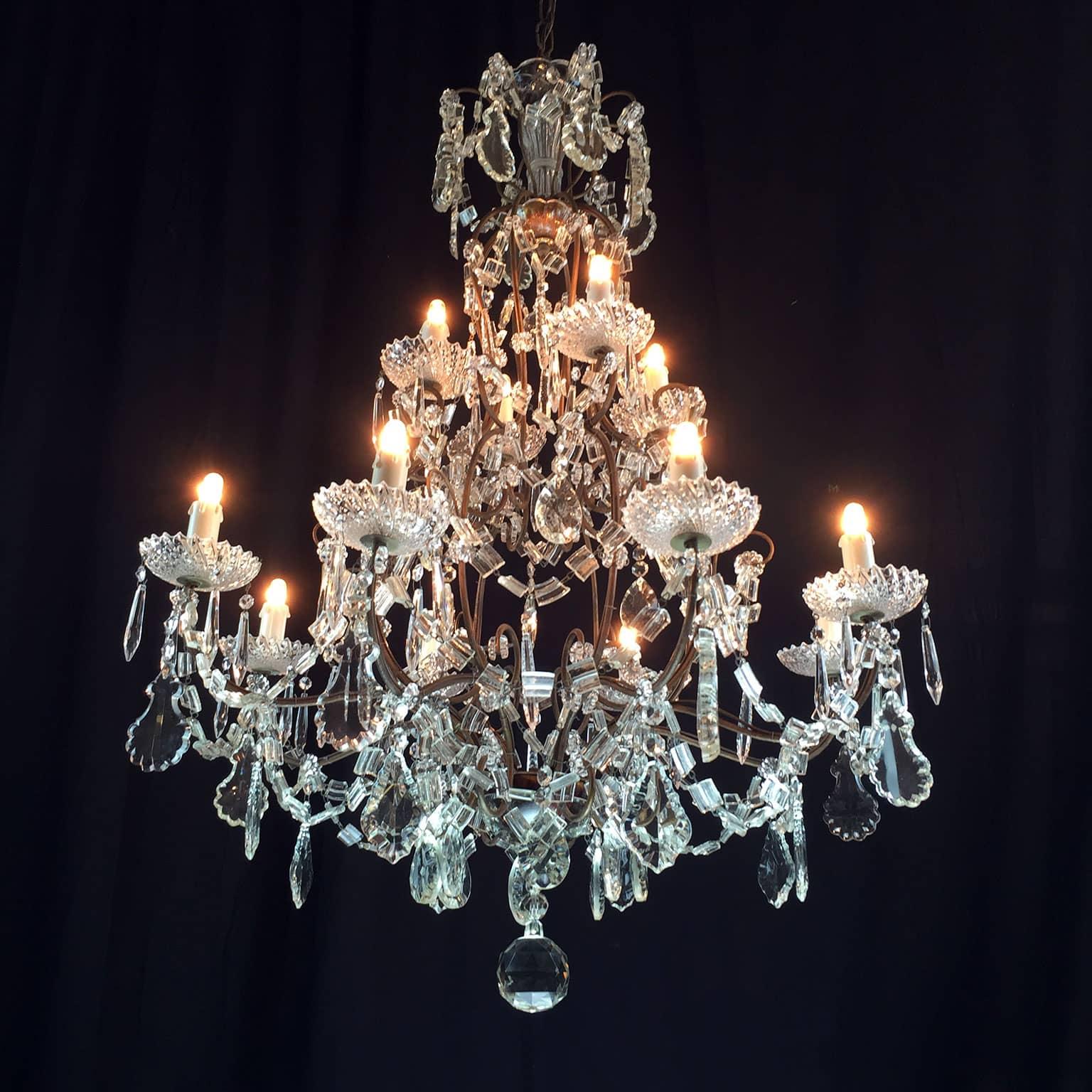 Lampadario antico in cristallo a 12 luci for Lampadario ventaglio