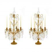 coppia di flambeaux in bronzo dorato e cristallo a sei fiamme