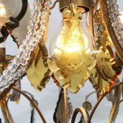 lampadario in cristallo trasparente e ambra a cinque luci e