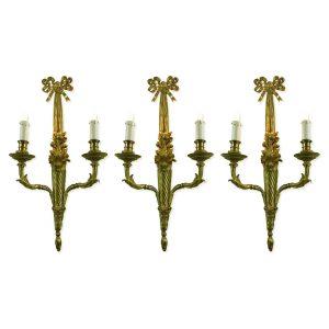 tre appliques in bronzo dorato