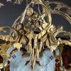 lanterna in bronzo dorato con vetri decorati a
