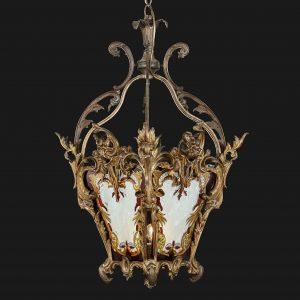 lanterna in bronzo dorato con vetri decorati